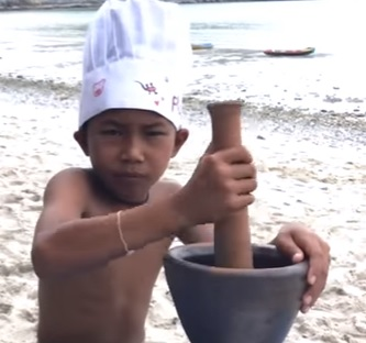 Thai chef cooking fish on a beach!